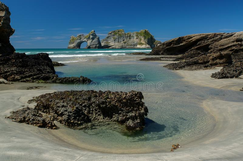 Wharariki Beach & Archway Islands in New Zealand royalty free stock photos
