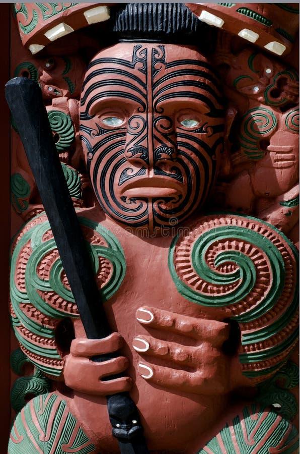 Whare Waka (Canoe house). Traditional Maori wall carvings in New Zealand royalty free stock photos