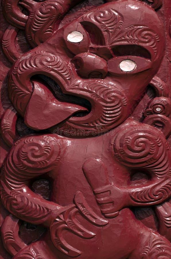Whare Waka (Canoe house). Traditional Maori wall carvings in New Zealand stock photos