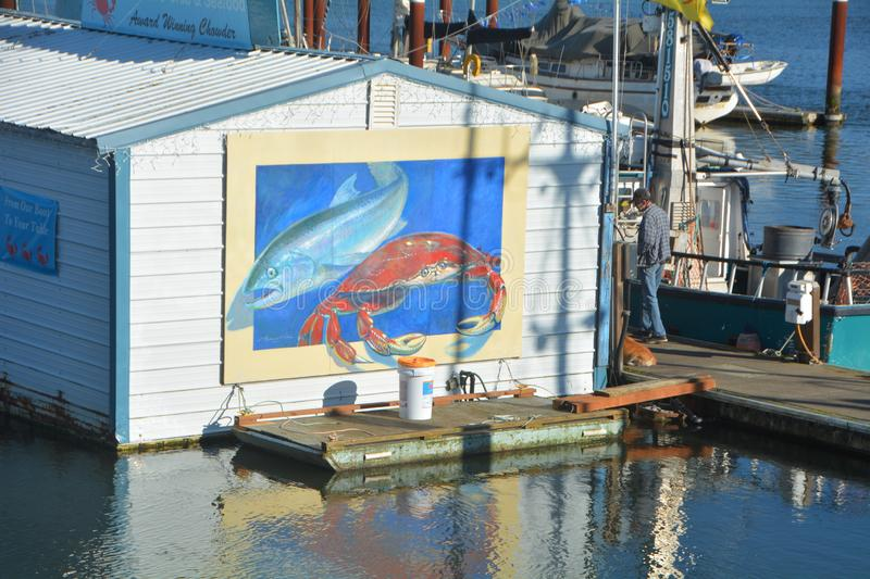 Wharf Mural in Florence, Oregon: horizontal. This is a crab and fish mural on the Florence, Oregon wharf stock photography