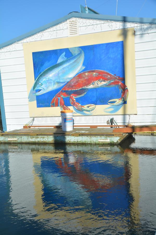 Wharf Mural in Florence, Oregon: vertical. This is a crab and fish mural on the Florence, Oregon wharf stock photo
