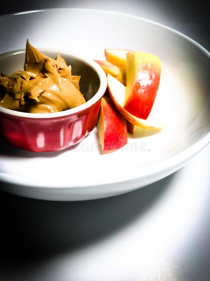 What's in The White Bowl? Sliced Apples and Peanut Butter royalty free stock photos