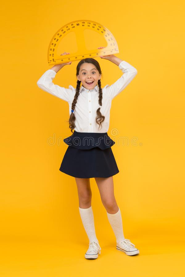 What angle you look. stem class. Math science. back to school. Mathematics education. Kid in uniform on yellow royalty free stock photos