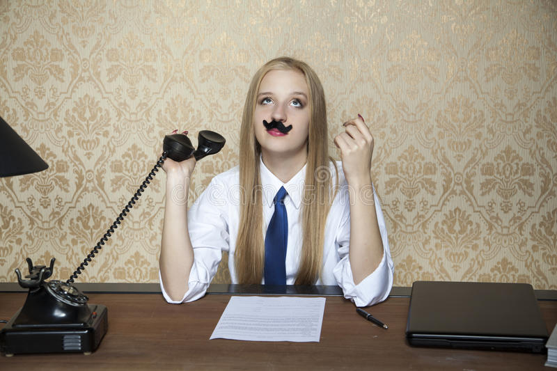 What a boring conversation on the phone. Business woman royalty free stock images