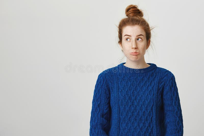 What a bummer. Portrait of frustrated attractive redhead caucasian female student in winter sweater sulking and looking royalty free stock image