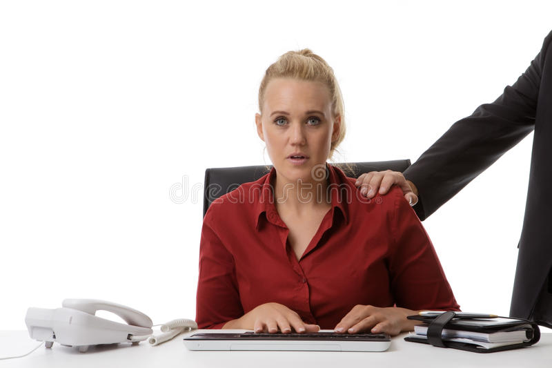 What can I do. Harassment in the work place of a young woman stock photos