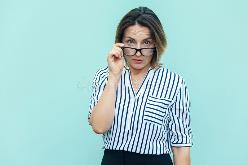 What did you say? Seriosly blonde busines woman and boss with glass looking at camera. stock images
