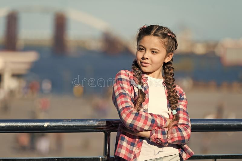 What do on holidays. Sunny day walk. Leisure options. Free time and leisure. Girl cute kid with braids relaxing urban stock images