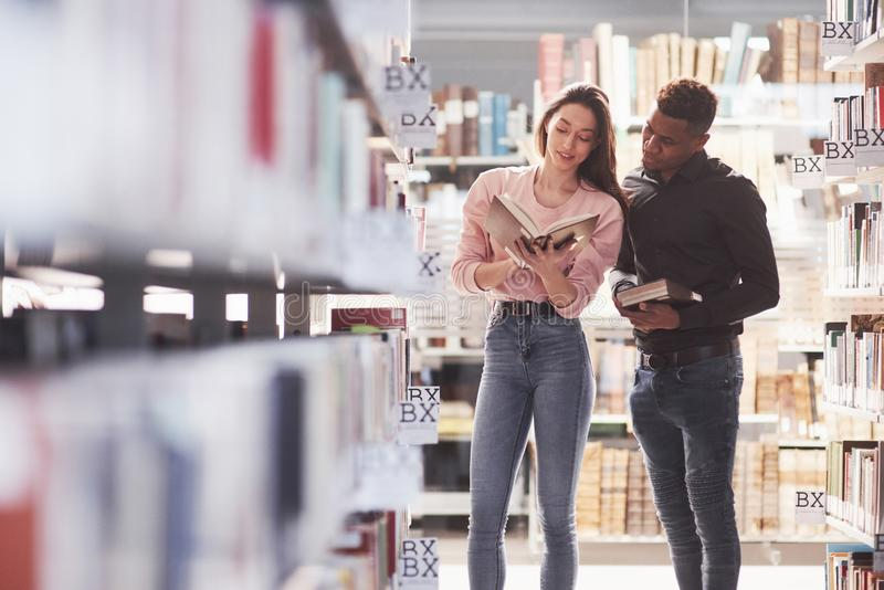 What do you think about this. Multiracial students in the library searching for the information together.  stock photography
