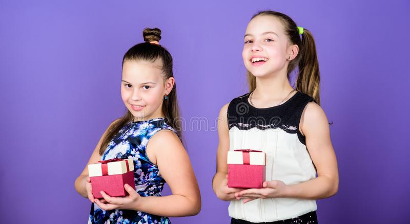 What do you think about this one. Boxing day. Christmas shopping. Surprise. Family sisterhood. Happy birthday. Holiday. Celebration. Small girls with present stock photos