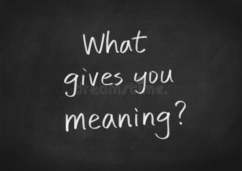 What gives you meaning. Text on blackboard background stock illustration