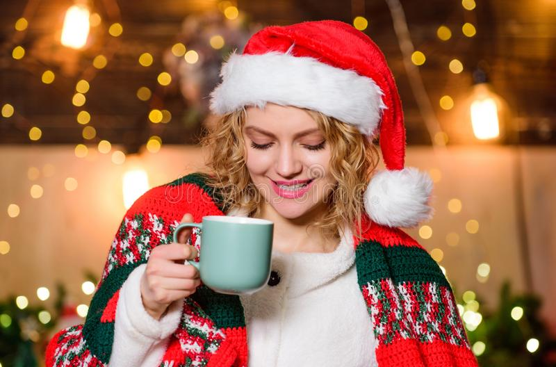 What a great morning. happy new year. Christmas. girl santa hat milk cup. xmas mood. Woman drink cocoa. Cheerful woman royalty free stock photos