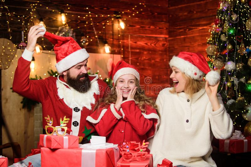 What a great surprise. Winter holidays. merry christmas. Father and mother love daughter. Portrait loving family. small stock photography