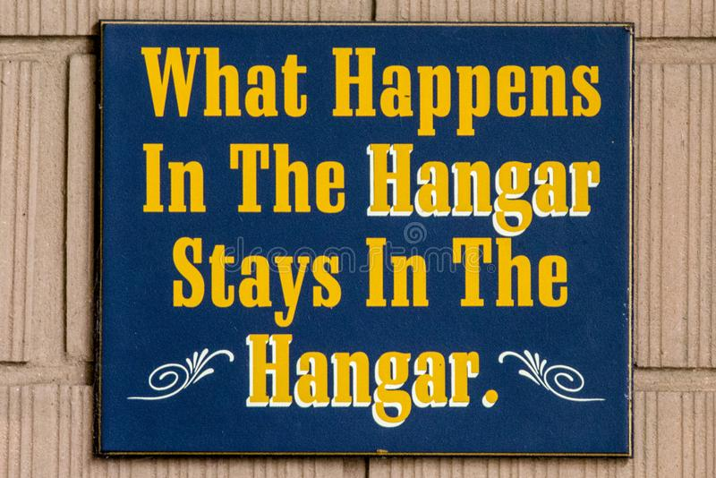 What happens in the hangar stays in the hangar sign stock photos