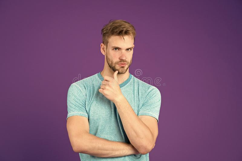 What is on his mind. Man with strong muscular arms. Does having muscular body make you more confident. Man muscular stock photography
