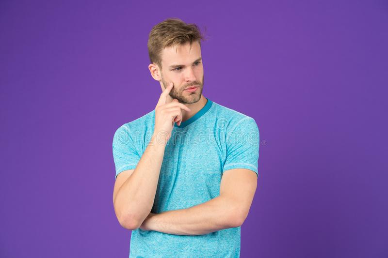 What is on his mind. Masculinity concept. Man with strong muscular arms. Does having muscular body make you more. Confident. Man muscular handsome unshaven royalty free stock image