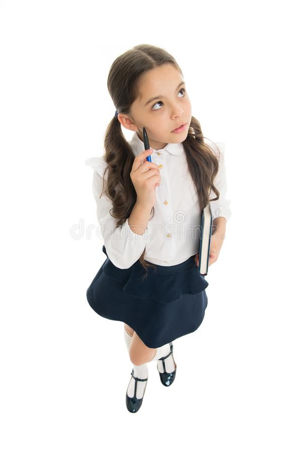 What if. Child school uniform kid doing homework. Girl school clothes hold book and pen. Girl cute write down idea notes. Notes to remember. Write essay or stock photo