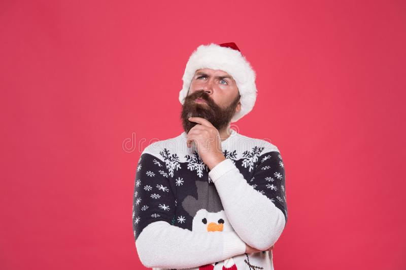What if. Hipster bearded man wear winter sweater and hat. Happy new year. Winter plan. Man thoughtful face expression royalty free stock image