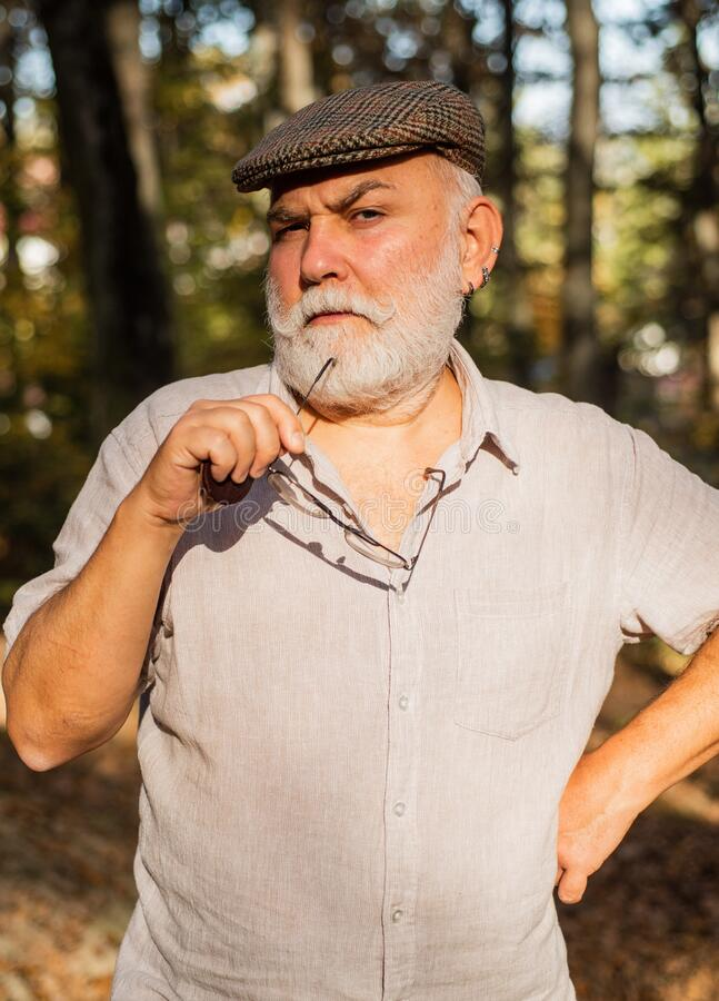 What if. Thinking man. Meaning of life. Elderly people care. Nursing home. True values. Pensioner relax autumn nature. Natural environment. Fresh air. Idyllic stock photography