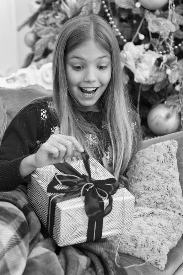 What is inside. The morning before Xmas. Little girl. Happy new year. Winter. xmas online shopping. Family holiday. Christmas tree and presents. Child enjoy royalty free stock photography