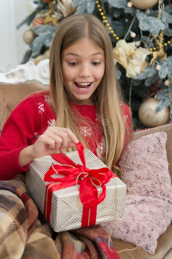 What is inside. The morning before Xmas. Little girl. Happy new year. Winter. xmas online shopping. Family holiday. Christmas tree and presents. Child enjoy royalty free stock image