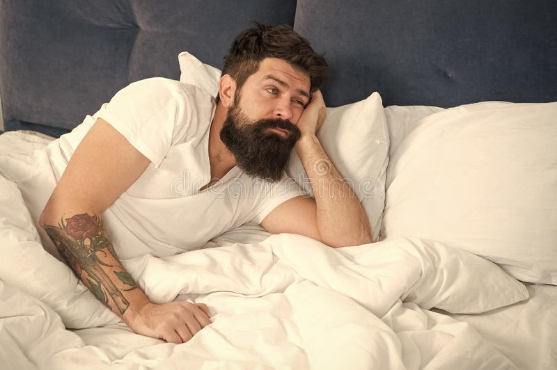What a long night. Sleep disorders concept. Man bearded hipster having problems with sleep. Guy lying in bed try to. Relax and fall asleep. Relaxation stock images