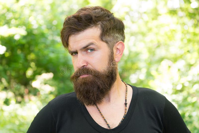 This is what man wants to look like. Bearded man in casual style on natural landscape. Caucasian man with long mustache. And beard hair outdoor. Brutal man with stock photography