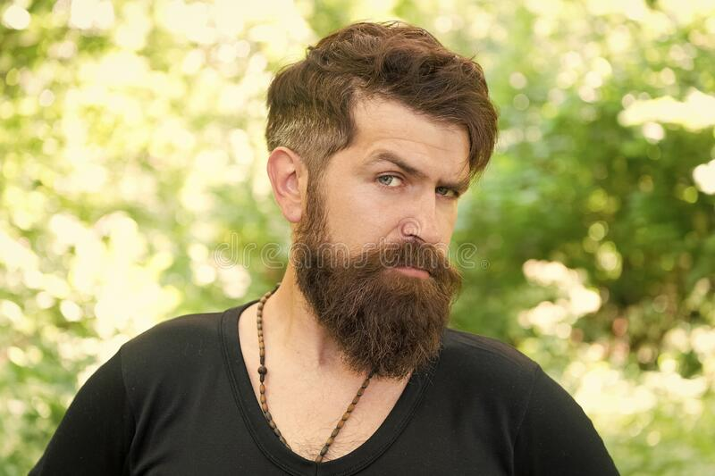 This is what man wants to look like. Bearded man in casual style on natural landscape. Caucasian man with long mustache royalty free stock photos