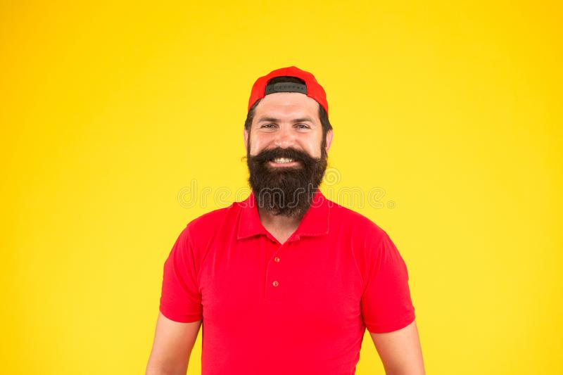 What a nice day. bearded man red shirt and cap. male summer fashion. Barber salon and facial hair care. being trendy and stock images