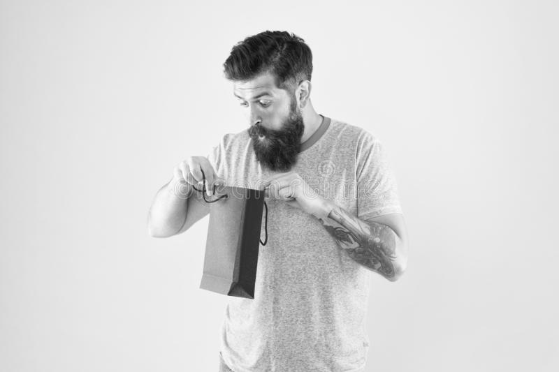 What a nice surprise. store for men. mature male beard with purchase. surprised hipster hold red paperbag. best offer royalty free stock image