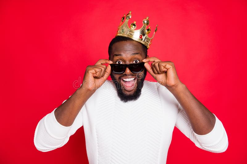 What... Prom party king. Really. Close up photo of amazed funky dark skin man hear unbelievable news scream wow omg. What... Prom party king. Really. Close up stock image