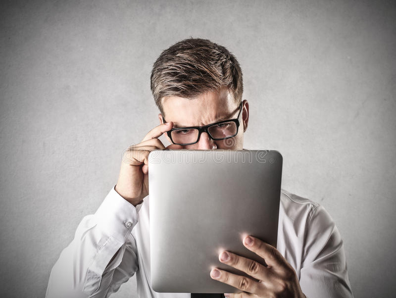 What's on?. A man is looking what's on a tablet stock photos