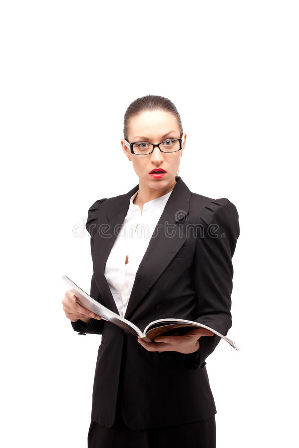 What's the news? I'm shocked!. Young business woman is shocked about article she read in magazine. Lots of copyspace for your content royalty free stock photo