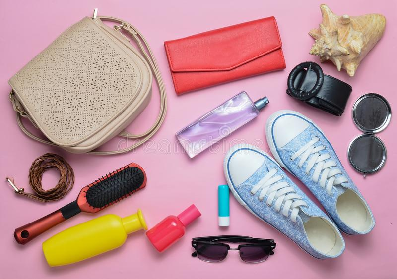 What& x27;s in the women& x27;s bag? Going on a trip. Girly fashionable spring and summer accessories. royalty free stock photo