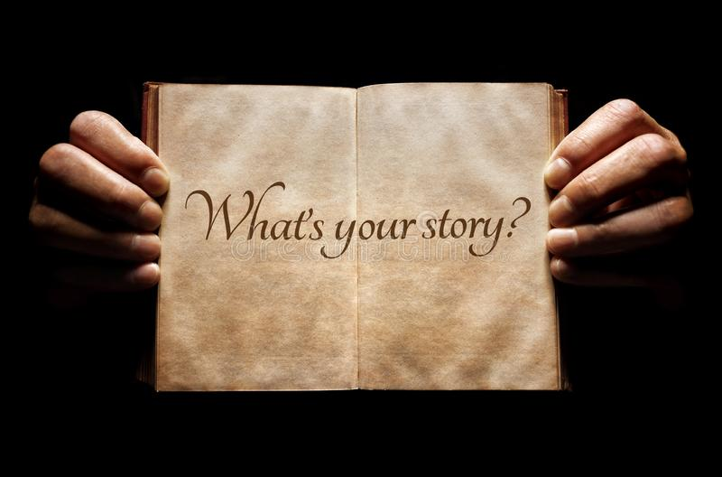 What`s your story? hands holding an open book background royalty free stock photos