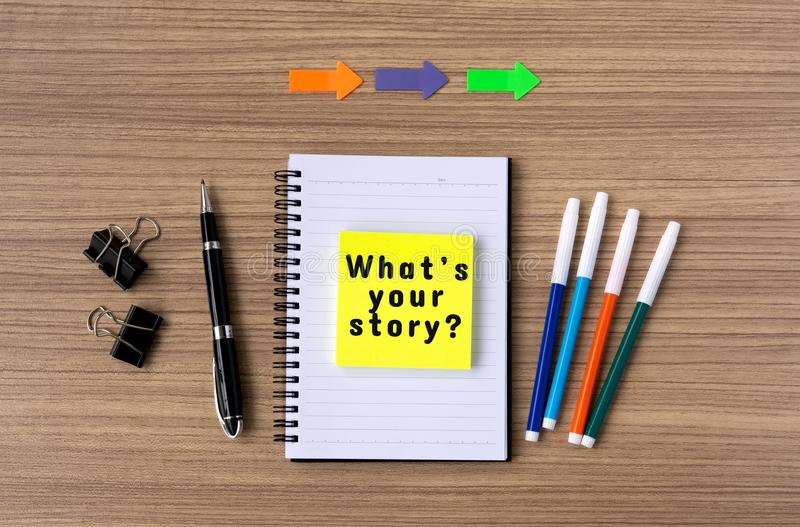 What`s your story on notepad stock photo