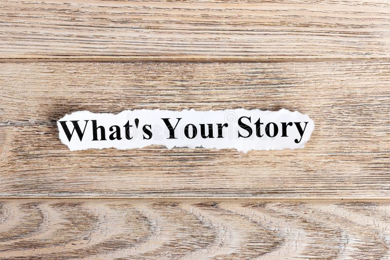 WHAT'S YOUR STORY text on paper. Word WHAT'S YOUR STORY on torn paper. Concept Image stock photo