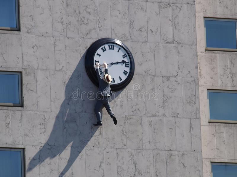 What some people to hold onto time. It`s a long way down but time is very special stock photography