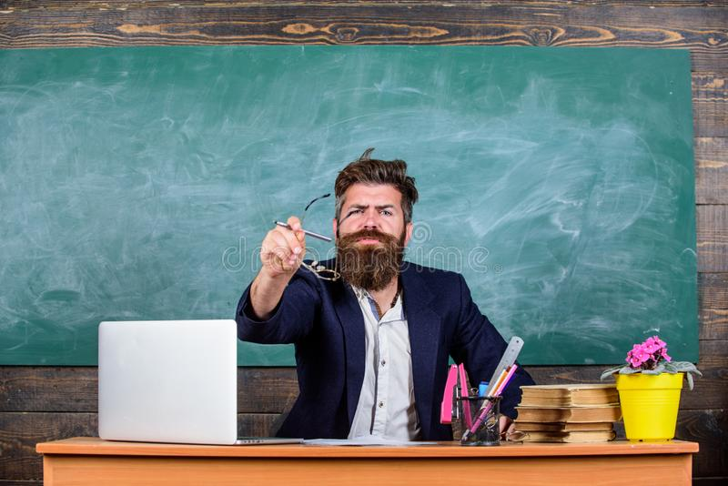 What stupid thought. Teacher wondered low level of knowledge. What are you talking about. Unpleasant wonder. Man bearded. Teacher wondering expression sit stock photo