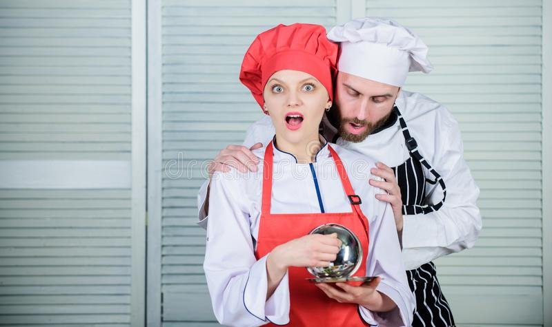 What a surprise for them. Family cooking in kitchen. secret ingredient by recipe. cook uniform. couple in love with royalty free stock photos