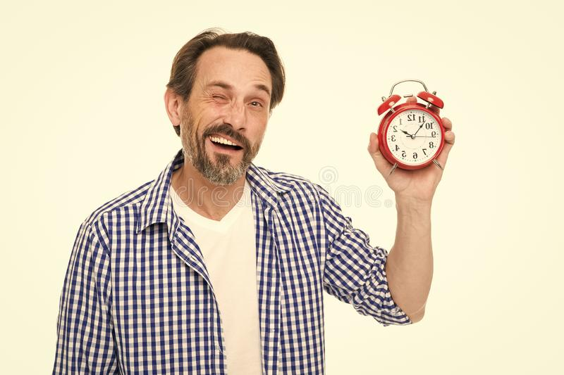 What time is it. Bearded senior man with mechanical clock in hand. Mature timekeeper with analog clock. Mature man royalty free stock images