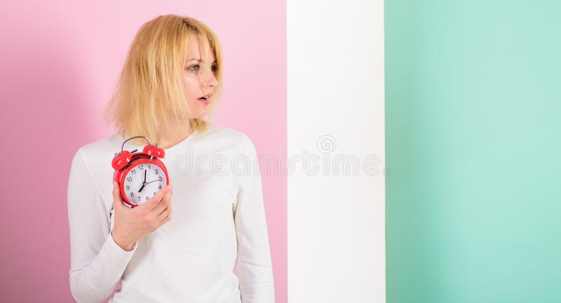 What time is it. Lack of sleep bad for health. Oversleeping side effects too much sleep harmful. Girl drowsy tousled royalty free stock photo
