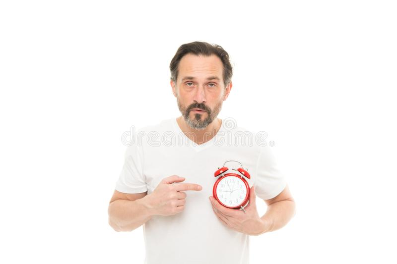 What time is it. Time management and discipline. Punctuality and responsibility. Man with clock on white background. Check time. Man hold alarm clock in hand royalty free stock image