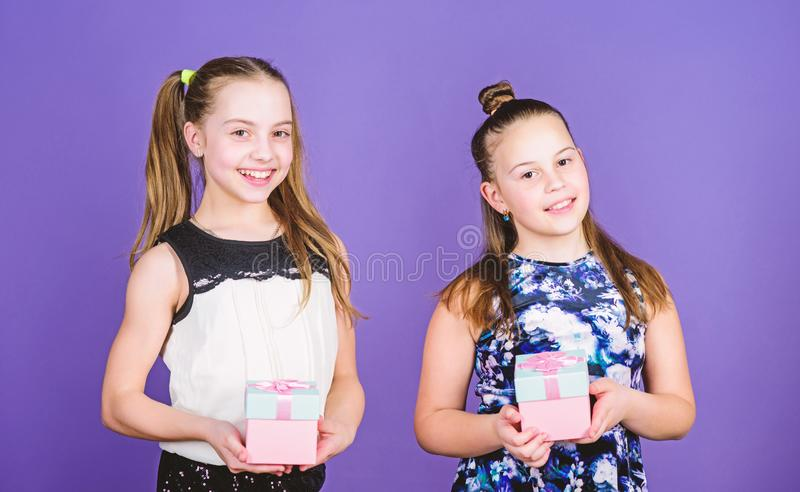 What to buy. Surprise. Family sisterhood congratulation. Small girls with present box. Happy birthday. Holiday stock photography