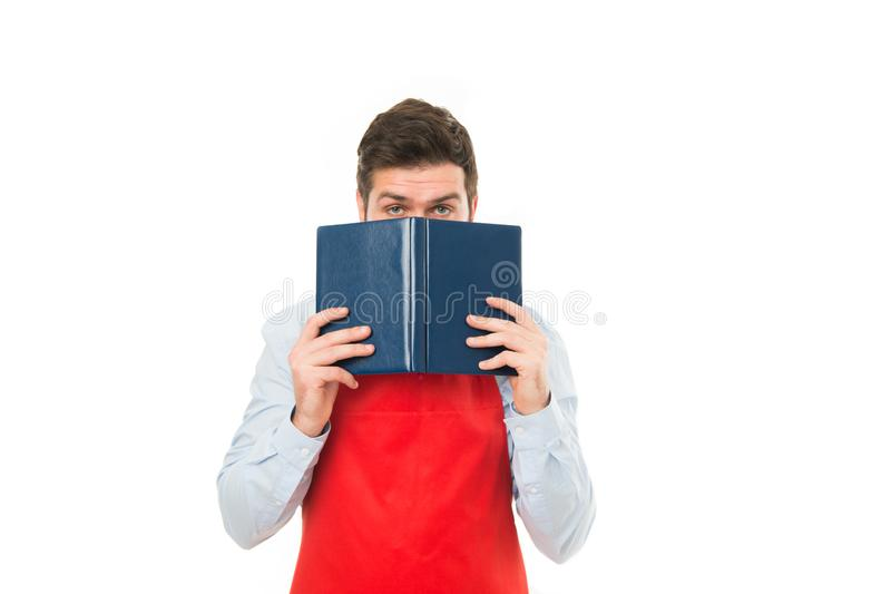 What to cook. Man hipster cook apron reading book about culinary. No idea how cook food. Culinary book concept. Man in royalty free stock photos