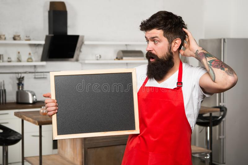 What to cook. urprise. This is what you need. Hipster in kitchen. Restaurant or cafe menu. Advertisement. Bearded man in royalty free stock photo