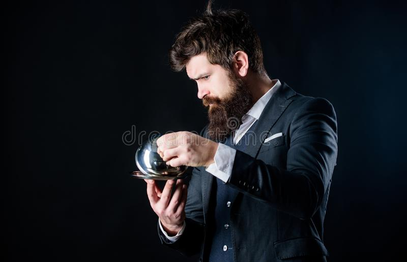 What is under cloche. Waiter luxury restaurant. Man well groomed gentleman formal suit hold little cloche. Serving and royalty free stock photo