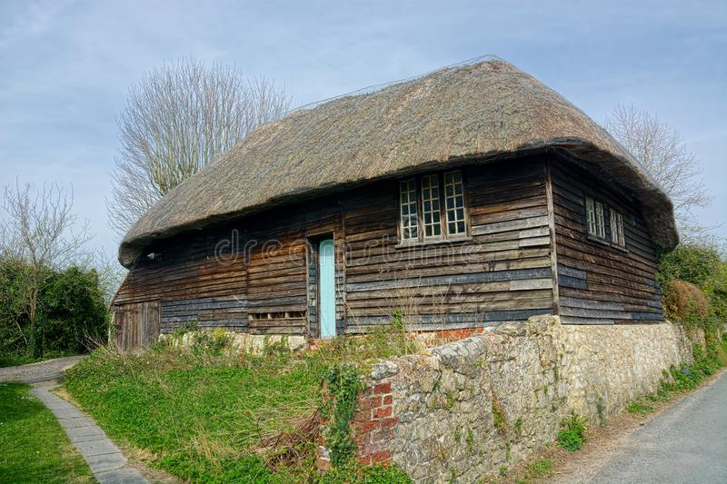 Decaying Wooden thatched storage building stock photo