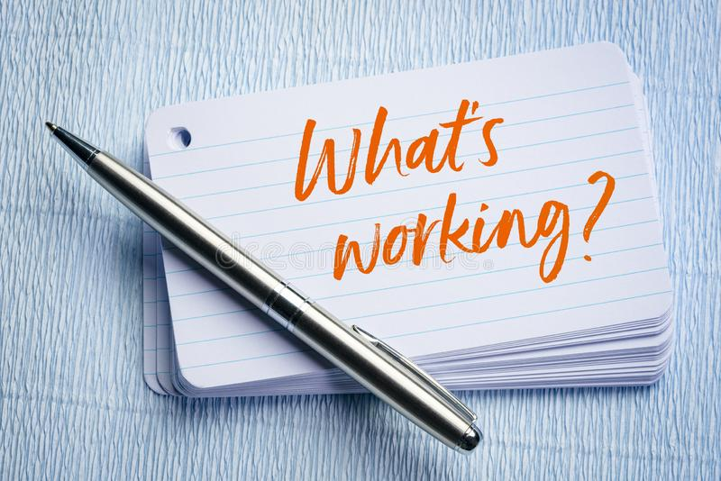 What is working. ? A question on a stack of index cards vector illustration
