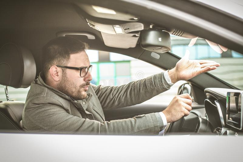 What you doing. Enraged male driver shouts and gestures threateningly royalty free stock photos